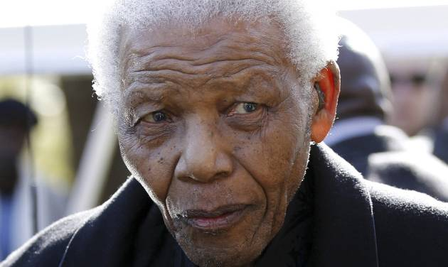 FILE - In this June 17, 2010 file photo, former South African President Nelson Mandela leaves the chapel after attending the funeral of his great-granddaughter Zenani Mandela in Johannesburg, South Africa. South Africa's presidency says Mandela was admitted to a hospital for a scheduled medical check-up, Saturday, March 9, 2013. (AP Photo/Siphiwe Sibeko, Pool, File)