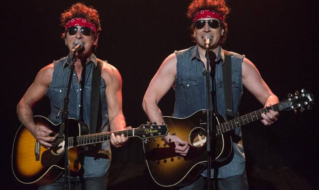 """This image released by NBC shows Bruce Springsteen, left, and Jimmy Fallon performing during """"Late Night with Jimmy Fallon,"""" on Tuesday, Jan. 14, 2014, in New York. (AP Photo/NBC, Lloyd Bishop)"""