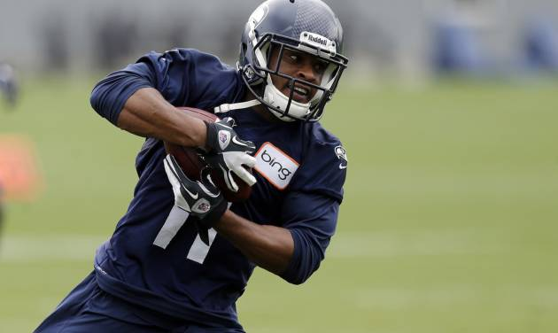 FILE - In this May 28, 2013, file photo, Seattle Seahawks wide receiver Percy Harvin carries the ball during a a drill at NFL football practice in Renton, Wash. Harvin will have hip surgery on Thursday, sidelining the dynamic wide receiver for the start of his first season with the Seahawks. (AP Photo/Ted S. Warren, File)