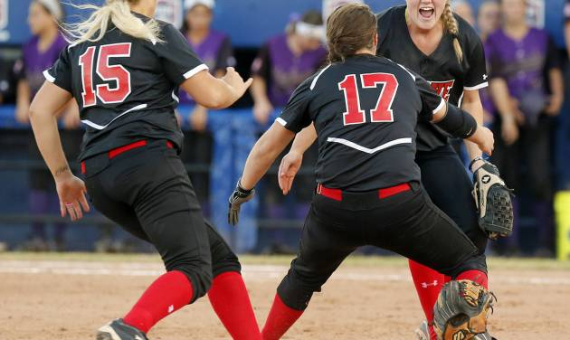 From left, Grove's Mason Jeffries (15), Taylor Dodson (17) and Jessica Walker (19) celebrate after wining the 5A state championship fast-pitch softball game against Chickasha at ASA Hall of Fame Stadium in Oklahoma City, Monday, Oct. 15, 2012. Grove won, 3-2. Photo by Nate Billings, The Oklahoman