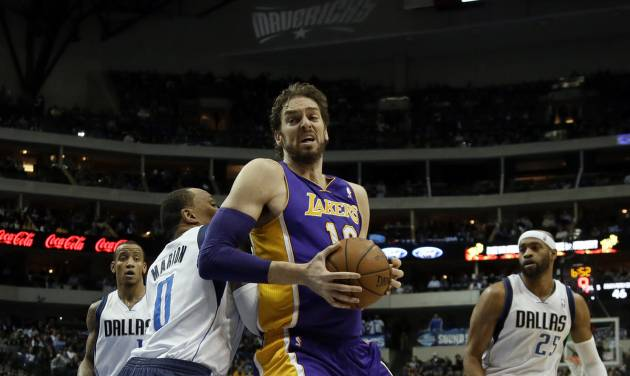 Dallas Mavericks' Shawn Marion (0) defends against a move to the basket by Los Angeles Lakers' Pau Gasol (16) of Spain as Vince Carter (25) and Monta Ellis, left rear, watch in the first half of an NBA basketball game, Tuesday, Jan. 7, 2014, in Dallas. (AP Photo/Tony Gutierrez)