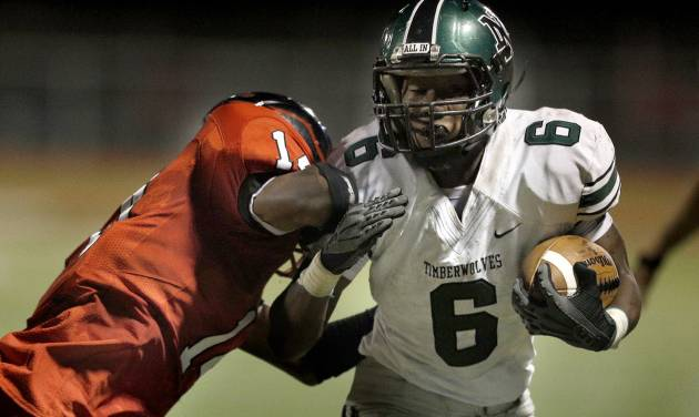 Norman North's Z'Quan Hogan is pushed out of bounds by Del City's Deonte Reid during the high school football game between Norman North and Del City at Del City, Okla., Friday, Sept. 13, 2013. Photo by Sarah Phipps, The Oklahoman