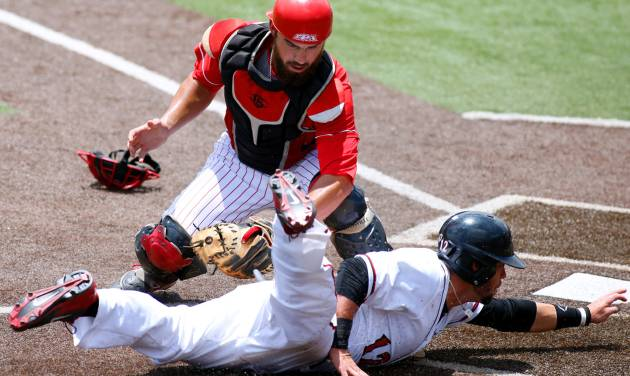 San Diego State's Tim Zier, bottom, is tagfed out at home plate by Louisiana-Lafayette catcher Michael Strentz, top, in the first inning of an NCAA college baseball tournament regional game in Lafayette, La., Saturday, May 31, 2014. (AP Photo/Jonathan Bachman)