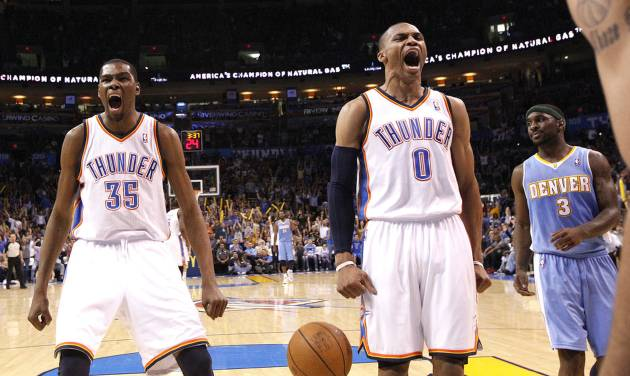 Oklahoma City's Kevin Durant (35) and Oklahoma City's Russell Westbrook (0) celebrate in front of Denver's Ty Lawson (3) during the NBA basketball game between the Oklahoma City Thunder and the Denver Nuggets, Friday, April 8, 2011, at the Oklahoma City Arena. Photo by Sarah Phipps, The Oklahoman