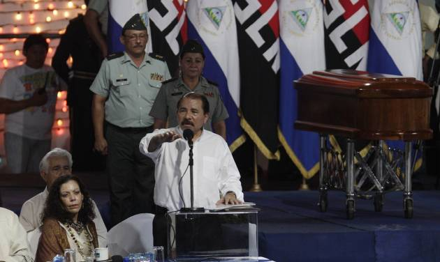FILE - In this May 2, 2012 file photo, Nicaragua's President Daniel Ortega speaks during a midnight funeral of the late Tomas Borge, the last surviving founder of the Sandinista guerrilla movement, in Managua, Nicaragua. At left is first lady Rosario Murillo. Borge, the country's powerful interior minister from 1979 to 1990 and Sandinista hard-liner died on April 30 at age 81 after being hospitalized for pneumonia and other ailments. In death, Borge has been given near-saint status by Ortega and his wife. Critics suggest they are using the mourning to bolster the legitimacy of a government whose last election was widely questioned. (AP Photo/Arnulfo Franco, File)