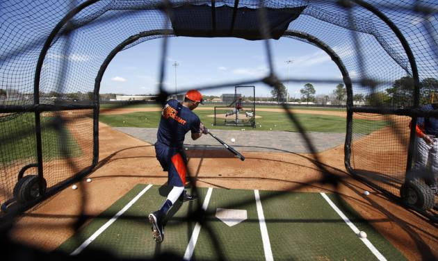 Houston Astros infielder Carlos Correa hits during a spring training baseball workout, Wednesday, Feb. 19, 2014, in Kissimmee, Fla. (AP Photo/Alex Brandon)