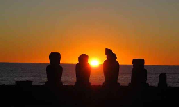 This August 2012 photo shows the sunset behind the Ahu Vai Uri platform at Tahai on Easter Island. Tahai, within easy walking distance of the town of Hanga Roa, was restored between 1968 and 1970 and features three different platforms. (AP Photo/Karen Schwartz)