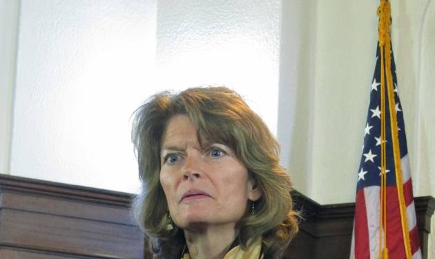 U.S. Sen. Lisa Murkowski addresses reporters during a news conference following her speech to a joint session of the Alaska Legislature on Wednesday, Feb. 19, 2014, in Juneau, Alaska. (AP Photo/Becky Bohrer)