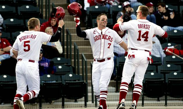 Colt Bickerstaff, left, Max White, center, and Matt Oberste meet at the plate after all three runners scored on a double by Anthony Hermelyn as the University of Oklahoma (OU) Sooners play Hofstra in NCAA college baseball at L. Dale Mitchell Field on Friday, Feb. 15, 2013  in Norman, Okla. Photo by Steve Sisney, The Oklahoman