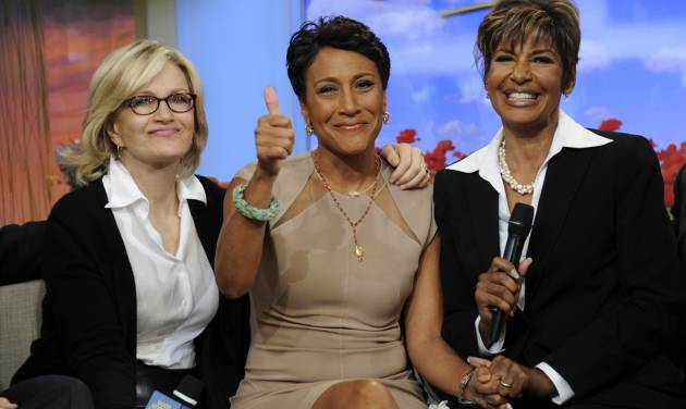 "This image released by ABC shows host Robin Roberts, center, with her sister Sally-Ann Roberts, right and ABC News' Diane Sawyer on ""Good Morning America"" Monday, June 11, 2012, after Robin Roberts announced she has been diagnosed with myelodysplastic syndrome, a blood and bone marrow disease once known as preleukemia. She says she will undergo chemo and a bone marrow transplant this year as ""pretreatment"" for the disease, which she says she has known about for several weeks. She says her sister is a great match for her. While she says she'll miss a day here and there, she'll remain on the air. (AP Photo/ABC, Ida Mae Astute)"