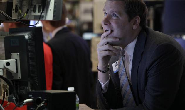 FILE- In this Monday, June 25, 2012, file photo, Specialist Gregg Maloney works on the floor of the New York Stock Exchange. Stock futures slid Thursday, June 28, 2012, on U.S. economic reports that showed only modest growth in the economy for the first three months of the year and a very slow recovery in the job market. (AP Photo/Richard Drew)