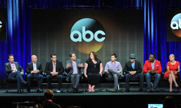 "FILE - In this Aug. 4, 2013 file photo, ""Lucky 7"" cast and crew, from left, Darryl Frank, Justin Falvey, Jason Richman, David Zabel, Lorraine Bruce, Matt Long, Luis Antonio Ramos, Isiah Whitlock, Jr. and Anastasia Phillips attend the Disney/ABC Television Group's 2013 Summer TCA panel at the Beverly Hilton Hotel in Beverly Hills, Calif. The ABC drama ""Lucky 7"" has won a dubious derby as the first television show of the new season to be cancelled. ABC said Friday, Oct. 4, 2013, the show is gone after two episodes. (Photo by Vince Bucci/Invision/AP, File)"