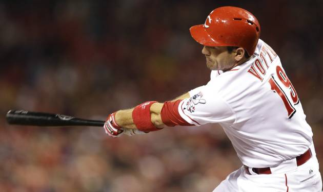 Cincinnati Reds' Joey Votto hits a double off St. Louis Cardinals starting pitcher Michael Wacha in the first inning of a baseball game, Wednesday, April 2, 2014, in Cincinnati. The hit was the 1,000th of Votto's career. (AP Photo/Al Behrman)