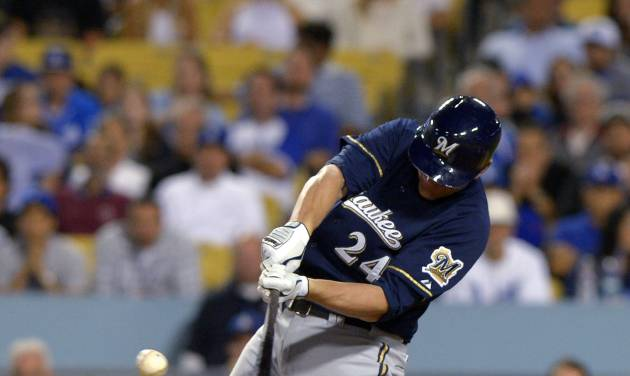 Milwaukee Brewers' Lyle Overbay hits a three-rundouble during the eighth inning of a baseball game against the Los Angeles on Dodgers, Friday, Aug. 15, 2014, in Los Angeles. (AP Photo/Mark J. Terrill)