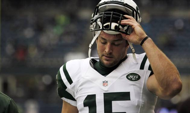 FILE - This Nov. 11, 2012 file photo shows New York Jets' Tim Tebow on the field before an NFL football game against the Seattle Seahawksin Seattle. Rex Ryan acknowledged Wednesday, Dec. 19, 2012 that he had higher expectations for the seldom-used Tebow in the Jets' wildcat-style offense. And, so did the NFL's most popular and maligned backup quarterback. (AP Photo/Elaine Thompson, File)