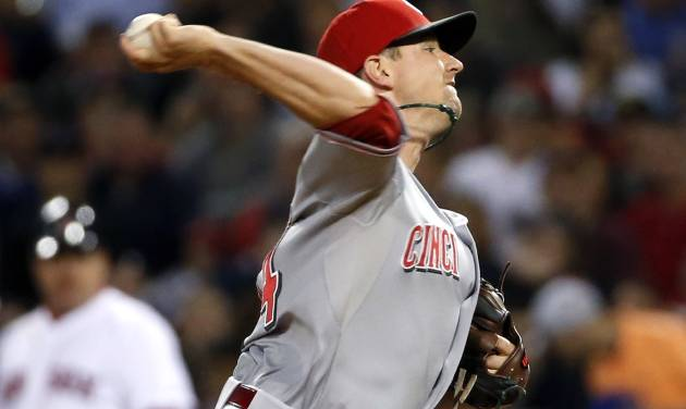 Cincinnati Reds starting pitcher Mike Leake delivers to the Boston Red Sox during the sixth inning of a baseball game at Fenway Park in Boston, Wednesday, May 7, 2014. (AP Photo/Elise Amendola)