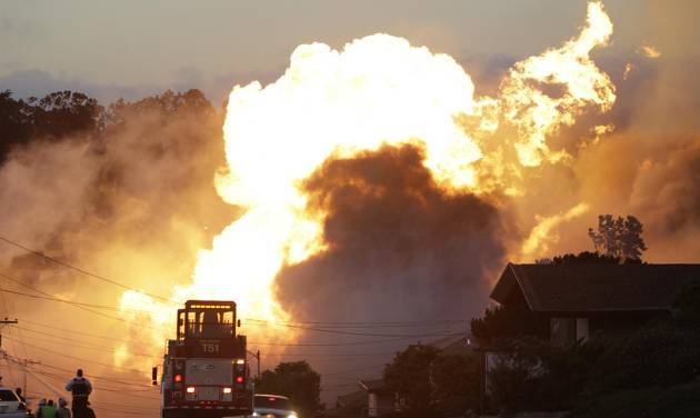 File - In this Sept. 9, 2010 file photo, a massive fire roars through a mostly residential neighborhood in San Bruno, Calif. California regulatory judges issued a $1.4 billion penalty on Tuesday, Sept. 2, 2014 against the state's largest utility for a lethal 2010 gas pipeline explosion that engulfed a suburban San Francisco neighborhood in flames, killing eight people and prompting national alerts about the oversight of aging pipelines. (AP Photo/Paul Sakuma, File)