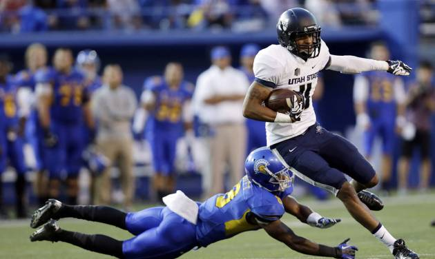 Utah State wide receiver Brandon Swindall runs past San Jose State cornerback Jimmy Pruitt after a catch during the first half of an NCAA college football game Friday, Sept. 27, 2013, in San Jose, Calif. (AP Photo/Marcio Jose Sanchez)