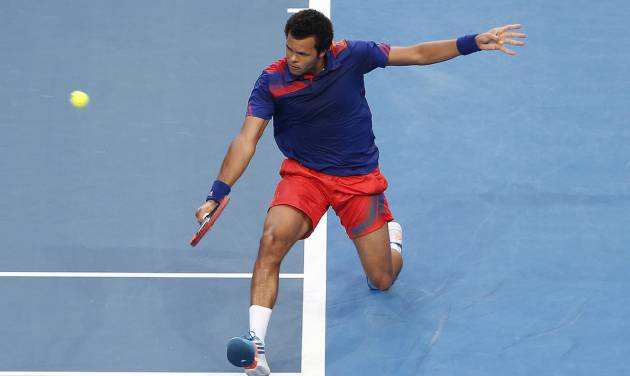 Jo-Wilfried Tsonga of France plays a backhand shot to Grzegorz Panfil of Poland during the men's final, Saturday, Jan. 4, 2014, at the Hopman Cup tennis tournament in Perth Australia. Tsonga won the match 6-3, 3-6, 6-3. (AP Photo/Theron Kirkman)