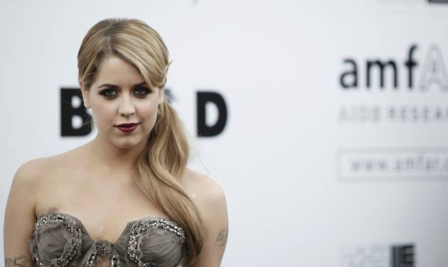 FILE - In this Thursday, May 21, 2009, file photo, British socialite Peaches Geldof arrives for the amfAR Cinema Against AIDS benefit at the Hotel du Cap-Eden-Roc, during the 62nd Cannes International film festival, in Antibes, southern France. Entertainer Bob Geldof's agent says his 25-year-old daughter Peaches has died. (AP Photo/Matt Sayles, File)
