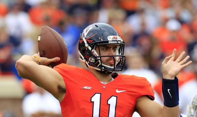 Virginia quarterback Greyson Lambert (11) throws a pass during the first half of an NCAA college football game against UCLA at Scott Stadium, Saturday, Aug. 30, 2014, in Charlottesville, Va. (AP Photo/Andrew Shurtleff)