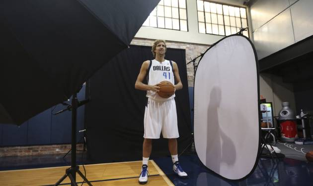 **CORRECTS DAY TO FRIDAY** Dallas Mavericks Dirk Nowitzki of Germany posses for a photo during team's media day Friday Sept. 28, 2012, in Dallas. Nowitzki again has a lot of new teammates with the Mavericks. For the second year in a row, this time after being swept out of the playoffs instead of winning the NBA title, the Mavs have drastically altered their roster. (AP Photo/LM Otero)