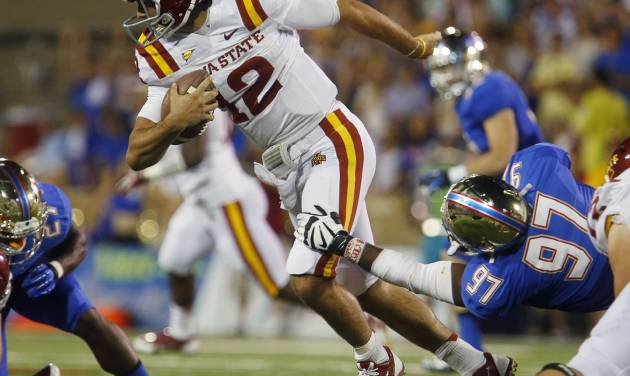 Iowa State's Sam Richardson (12)  is taken down Tulsa's Brentom Todd (97) during the first half of an NCAA college football game, Thursday, Sept. 26, 2013 in Tulsa, Okla. (AP Photo/Tulsa World, Tom Gilbert)  ONLINE OUT; TV OUT; TULSA OUT