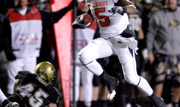 OSU's Keith Toston leaps to try to get by Colorado's Jeff Smart during the college football game between Oklahoma State University and the University of Colorado at Folsom Field in Boulder, Colo., Saturday, Nov. 15, 2008. BY BRYAN TERRY, THE OKLAHOMAN