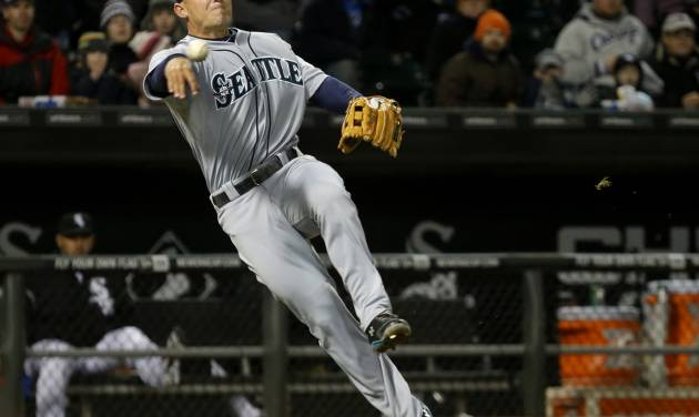 Seattle Mariners third baseman Kyle Seager fields a bunt by Chicago White Sox's Alejandro De Aza and throws him out at first during the third inning of a baseball game on Friday, April 5, 2013, in Chicago. (AP Photo/Charles Rex Arbogast)