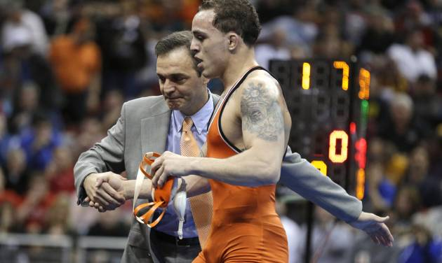 Oklahoma State's Jordan Oliver received congratulations from coach John Smith after Oliver defeated Boise Stateís Jason Chamberlain in the 149-pound title match at the NCAA Division I wrestling championships, Saturday, March 23, 2013, in Des Moines, Iowa. (AP Photo/Charlie Neibergall)