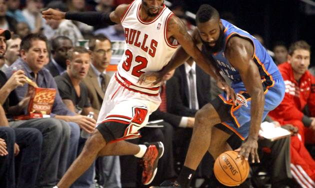 Chicago Bulls guard Richard Hamilton (32) battles Oklahoma City Thunder guard James Harden for the ball during the first half of an NBA preseason basketball game, Tuesday, Oct. 23, 2012, in Chicago. (AP Photo/Charles Rex Arbogast)