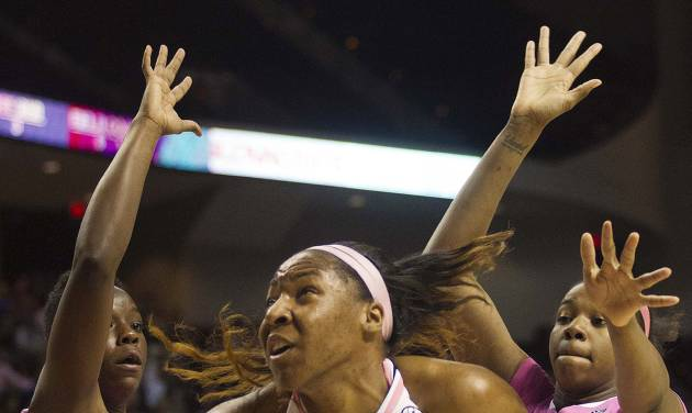 Texas A&M center Kelsey Bone (3) drives to the basket against Kentucky forward Samarie Walker, left, and DeNesha Stallworth during the first half of an NCAA college basketball game, Monday, Feb. 18, 2013, in College Station, Texas. (AP Photo/Patric Schneider)