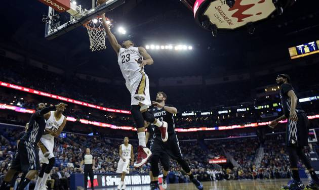 New Orleans Pelicans power forward Anthony Davis (23) goes to the basket in front of Minnesota Timberwolves power forward Kevin Love (42) in the first half of an NBA basketball game in New Orleans, Friday, Feb. 7, 2014. (AP Photo/Gerald Herbert)