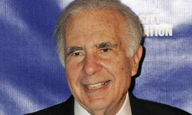 FILE - In this March 16, 2010 file photo, financier Carl Icahn poses for photos upon arriving for the 32nd annual New York City Police Foundation Gala in New York. Under a deal announced Thursday, April 10, 2014, Icahn is backing down from his push to remake eBay, settling an acrimonious dispute just ahead of what promised to be an awkward annual shareholders meeting. (AP Photo/Henny Ray Abrams, File)