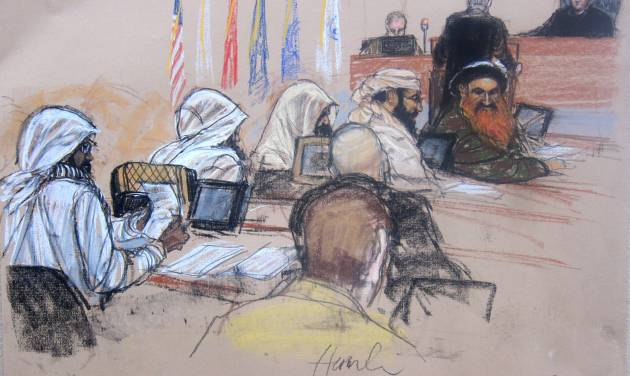 In this Pentagon-approved sketch by court artist Janet Hamlin,  the Sept. 11 accused co-conspirators attend a pretrial hearing the Guantanamo Bay U.S. Naval Base in Cuba, Monday, June 16, 2014. Defense council James Herrington is at podium addressing presiding Judge James Pohl. The accused, right to left: Khalid Sheikh Mohmmad, Walid bin Attash, Ramzi bin al shibh, Aziz Ali, Mustafa al Hawsawi.  Lawyers for Guantanamo prisoners charged in the Sept. 11 attack say the FBI has questioned more people who work as support staff on their legal teams than previously disclosed, a development that may prompt a new detour in an already snarled case as the war crimes tribunal reconvened Monday at this U.S. base.  (AP Photo/Janet Hamlin, Pool)