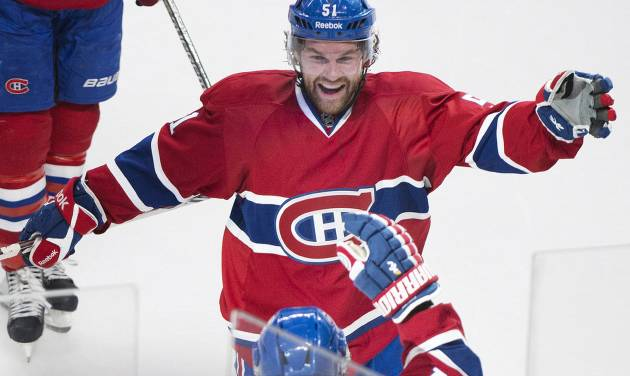 Montreal Canadiens' Brian Gionta, foreground, celebrates with teammate David Desharnais (51) after scoring the winning goal against the New York Rangers during overtime of an NHL hockey game, Saturday, April 12, 2014, in Montreal. Montreal won 1-0. (AP Photo/The Canadian Press, Graham Hughes)