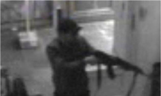 In this hand out photo distributed on Sunday, May 25, 2014 by the Belgian Federal Police, a surveillance camera shows a man shooting at the Jewish museum in Brussels, Belgium, on Saturday, May 24, 2014. Police stepped up security at Jewish institutions, schools and synagogues after three people were killed and one seriously injured in a spree of gunfire at the Jewish Museum in Brussels on Saturday. (AP Photo/Belgian Federal Police)