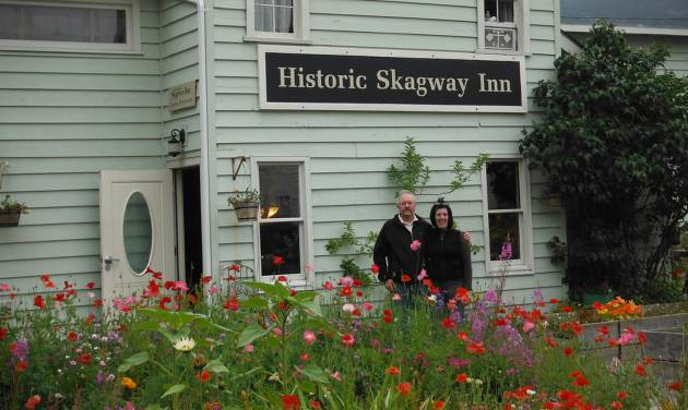 In this Aug. 2012 photo, Karl and Rosemary Klupar stand outside their business, The Historic Skagway Inn, in Skagway, Alaska. The bed and breakfast was used as a brothel during the gold rush days in the late 1800s. (AP Photo/Capital City Weekly, Amanda Compton)