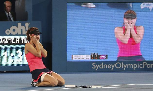 Tsvetana Pironkova of Bulgaria drops to her knees as she celebrates winning her finals match against Angelique Kerber of Germany during the Sydney International Tennis Tournament in Sydney, Australia, Friday, Jan. 10, 2014. (AP Photo/Rob Griffith)