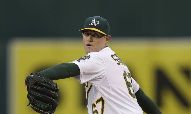 Oakland Athletics' Dan Straily works against the Texas Rangers in the first inning of a baseball game Monday, April 21, 2014, in Oakland, Calif. (AP Photo/Ben Margot)