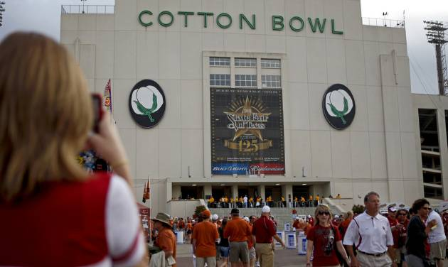 Fans walk outside the Cotton Bowl before the Red River Rivalry college football game between the University of Oklahoma Sooners (OU) and the University of Texas Longhorns (UT) at the Cotton Bowl in Dallas, Saturday, Oct. 8, 2011. Photo by Bryan Terry, The Oklahoman  ORG XMIT: KOD