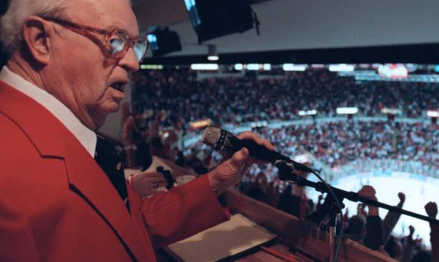 In a May 2002 photo Budd Lynch, the Detroit Red Wings' announcer, works a game in Detroit. The Detroit Red Wings said Tuesday Oct. 9, 2012, the team's longtime public address announcer Budd Lynch has died. He was 95. (AP Photo/Detroit Free Press,J. Kyle Keener ) DETROIT NEWS OUT; NO SALES: MANDATORY CREDIT
