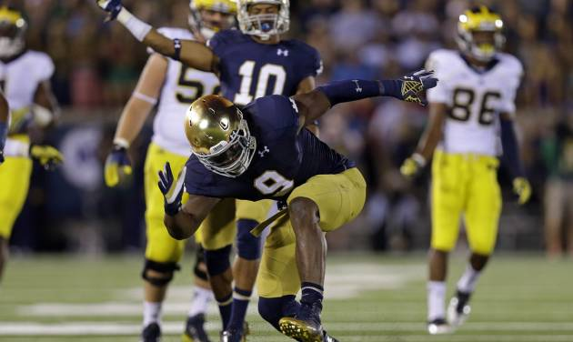 FILE - In this Sept. 6, 2014, file photo, Notre Dame linebacker Jaylon Smith celebrates a tackle for a loss against Michigan during the second half of an NCAA college football game in South Bend, Ind. Jaylon Smith is always up for a challenge. Now, the Notre Dame linebacker must assume greater leadership with Joe Schmidt out for the season and the No. 8 Fighting Irish next facing No. 11 Arizona State on the road. (AP Photo/Michael Conroy, File)