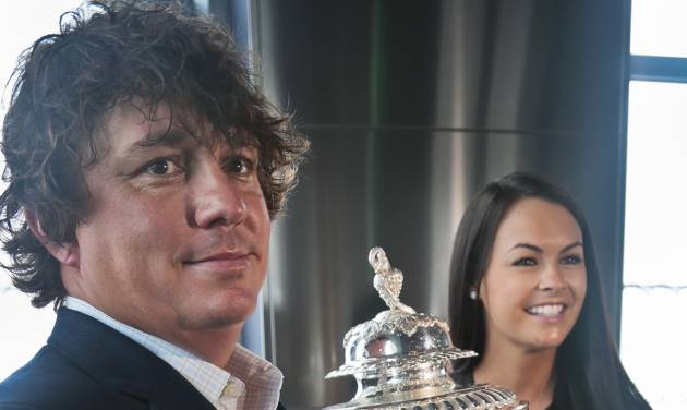Jason Dufner, left, 2013 PGA Championship golf tournament winner, and his wife, Amanda, pose with the championship trophy at the Empire State Building on Tuesday, Aug. 13, 2013 in New York.  Dufner claimed his first major title with a two-shot victory over Jim Furyk in the PGA Championship on Sunday. (AP Photo/Bebeto Matthews)
