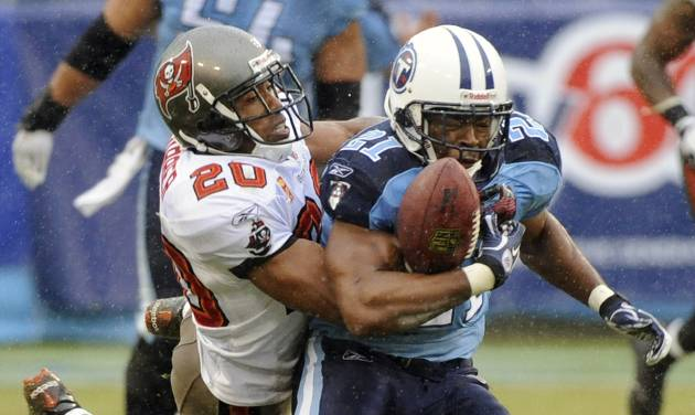 FILE - In this Sunday, Nov. 27, 2011 file photo, Tampa Bay Buccaneers cornerback Ronde Barber (20) knocks the ball out of the grasp of Tennessee Titans running back Javon Ringer (21) in the second quarter of an NFL football game in Nashville, Tenn. Most of the big names hitting NFL free agency in 2013 aren't big stars anymore. While Ed Reed is coming off a Super Bowl season in Baltimore and Wes Welker catches 100 passes every year, this crop is more about aging defensive players such as Charles Woodson, Brian Urlacher and Barber. (AP Photo/Frederick Breedon, File)