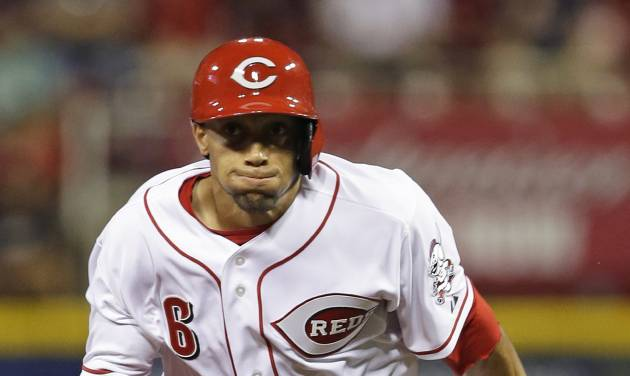 Cincinnati Reds' Billy Hamilton leaves second base on a double by Todd Frazier in the seventh inning of a baseball game against the St. Louis Cardinals, Tuesday, Sept. 3, 2013, in Cincinnati. Hamilton scored the only run of the game on the hit as the Reds won 1-0. (AP Photo/Al Behrman)
