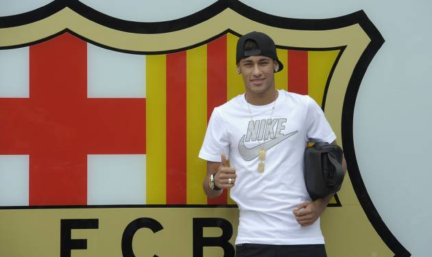 "FILE - In this June 3, 2013 file photo, FC Barcelona's then new signing Neymar gestures upon his arrival at the club's office at the Camp Nou stadium in Barcelona, Spain. A Spanish court has charged Spanish league champion Barcelona with tax fraud of  euro 9.1 million ($12.5 million) over the transfer of Brazil forward Neymar. Judge Pablo Ruz said in his decision, released on Thursday, Feb. 20, 2014 there was enough evidence to merit charges over Neymar's 57 million-euro (then $77 million) move from Santos last summer. Thursday's decision comes a day after public prosecutor Jose Perals charged Barcelona with fabricating simulated contracts and using ""financial engineering"" to defraud the Spanish Treasury. Barcelona has denied the charges. (AP Photo/Manu Fernandez, File)"