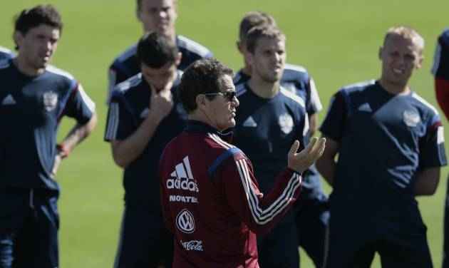 Fabio Capello, center, Italian coach of Russian national soccer team, talks to his players during a training session in Itu, Brazil, on Friday, June 13, 2014. Russia will play in group H of the 2014 soccer World Cup. (AP Photo/Ivan Sekretarev)