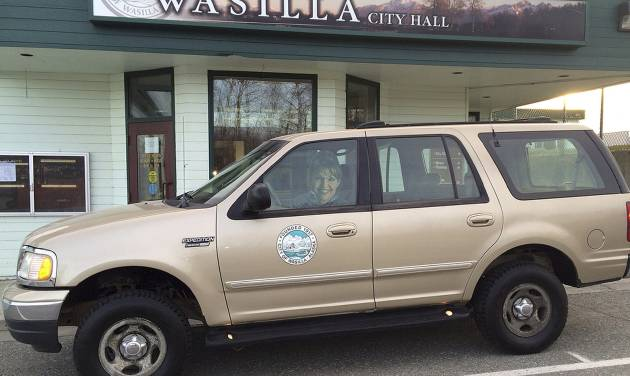 FILE - This Nov. 7, 2013 file photo provided by The City of Wasilla (Alaska) Department of Public Works shows a cardboard cutout of Sarah Palin in the 1999 Ford Expedition she used when she was mayor of Wasilla, outside City Hall in Wasilla, Ak. The sale of the vehicle used by Sarah Palin when she was mayor of an Alaska town is causing a stir. The city of Wasilla auctioned off the SUV on a website and will net about an $8,000 profit. The deputy mayor lost a fight to use the money to restock the local food bank, and is now accusing the current mayor of trying to enrich city coffers off Palin's name. (AP Photo/The City of Wasilla Department of Public Works, File)