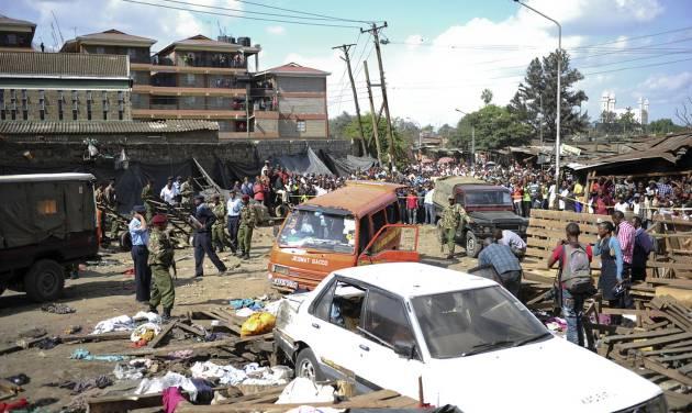 Security forces secure the scene at the site where two blasts detonated, one in a mini-van used for public transportation, in a market area of Nairobi, Kenya Friday, May 16, 2014. Two blasts hit Kenya's capital on Friday, killing a number of people and injuring many more, in what appeared to be the latest in a string of increasingly frequent terror attacks. (AP Photo)